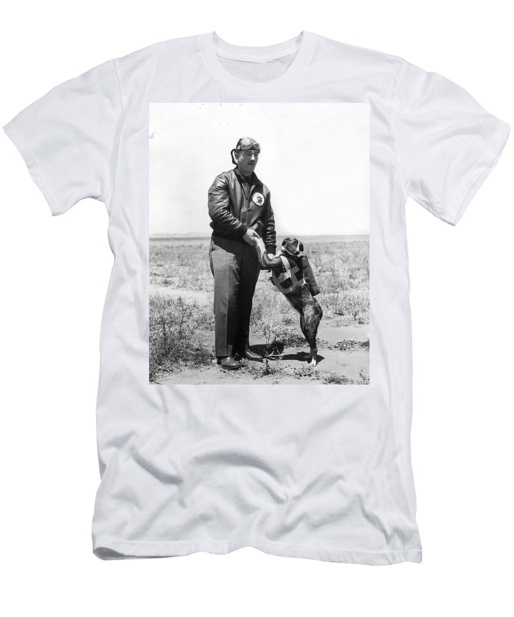 1 Person Men's T-Shirt (Athletic Fit) featuring the photograph The Parachute Pup by Underwood Archives