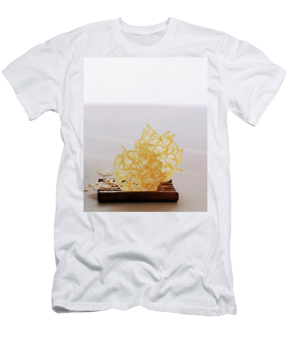 Food Men's T-Shirt (Athletic Fit) featuring the photograph Two Parmesan Onion Puffs by Romulo Yanes