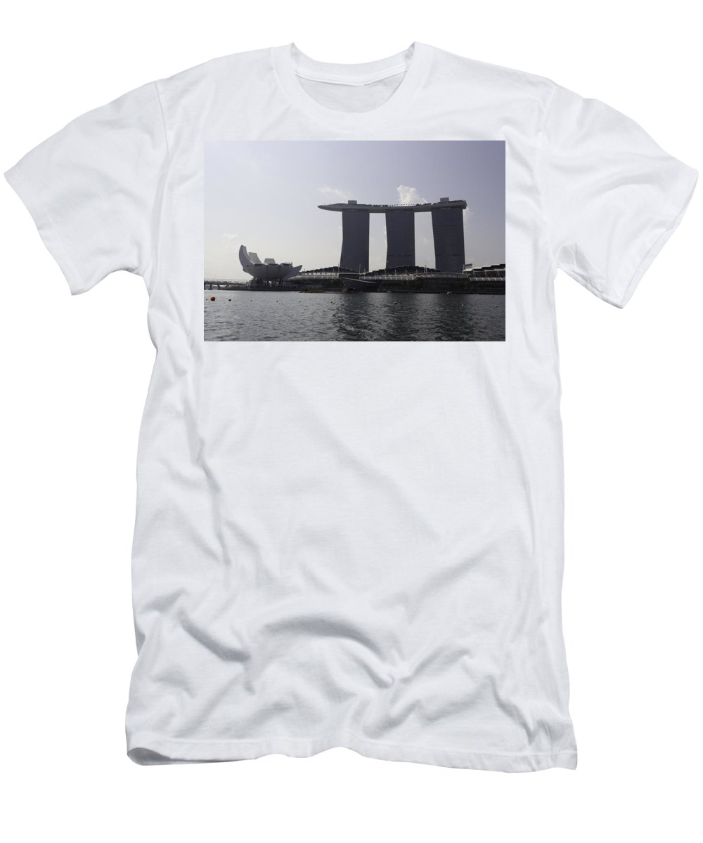 3 Towers Men's T-Shirt (Athletic Fit) featuring the photograph View Of The Artscience Museum And The Marina Bay Sands Resort by Ashish Agarwal