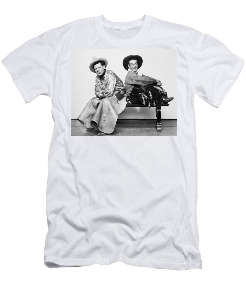 -cowboys- Men's T-Shirt (Athletic Fit) featuring the photograph Silent Film Still: Cowboys by Granger