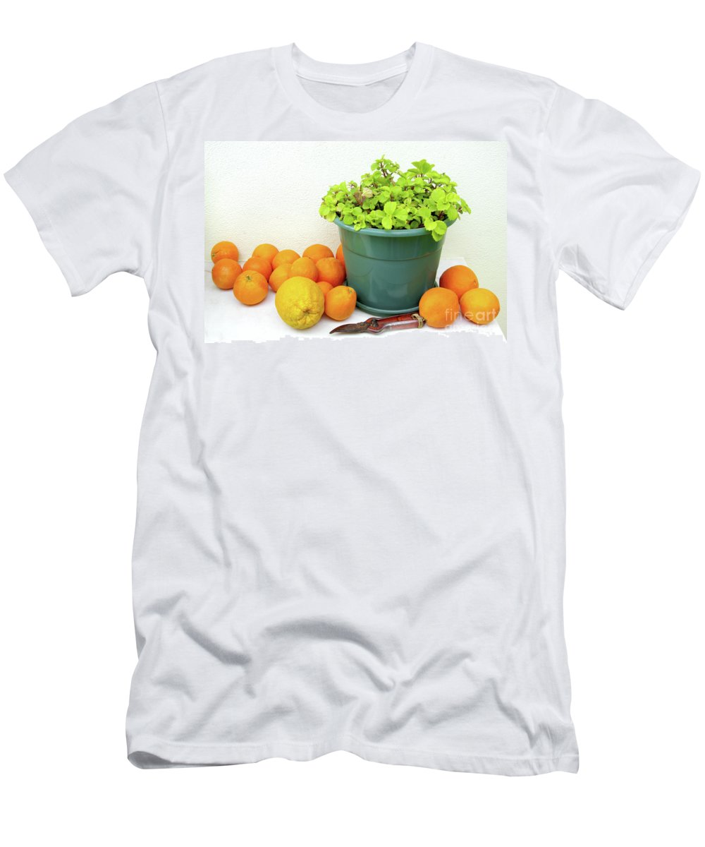 Back-light Men's T-Shirt (Athletic Fit) featuring the photograph Oranges And Vase by Carlos Caetano