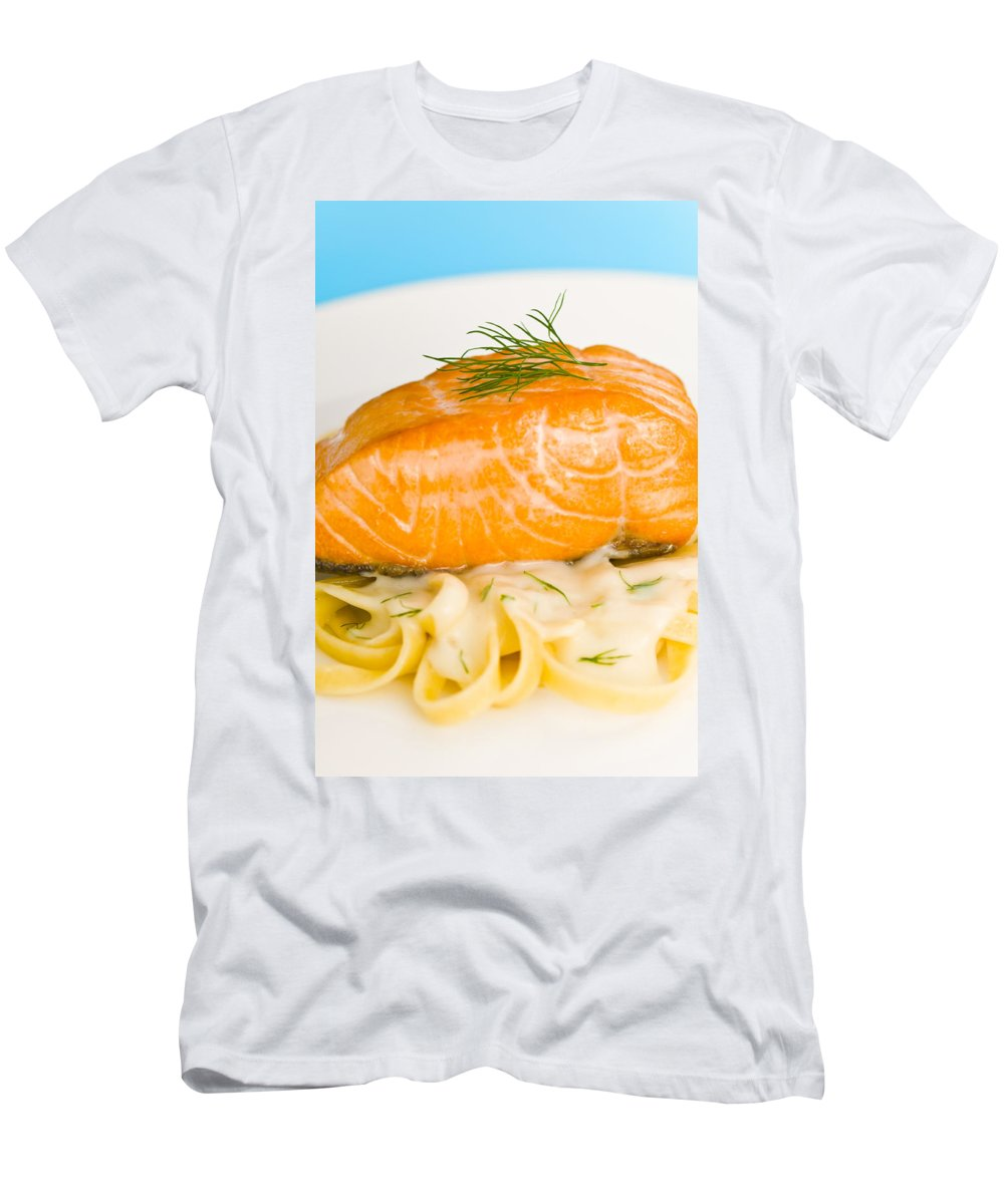 Wild Salmon Men's T-Shirt (Athletic Fit) featuring the photograph Salmon Steak On Pasta Decorated With Dill Closeup by U Schade