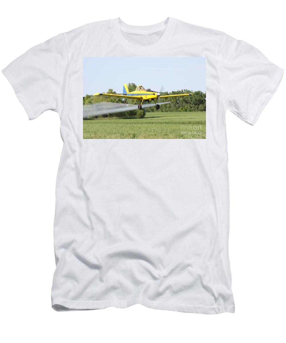 Plane Men's T-Shirt (Athletic Fit) featuring the photograph Crop Dusting Plane by Lori Tordsen