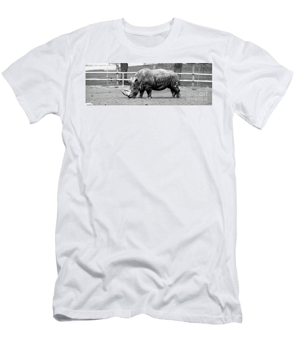 A Rhinoceros Men's T-Shirt (Athletic Fit) featuring the mixed media A Rhinoceros by Amitabh Dayal