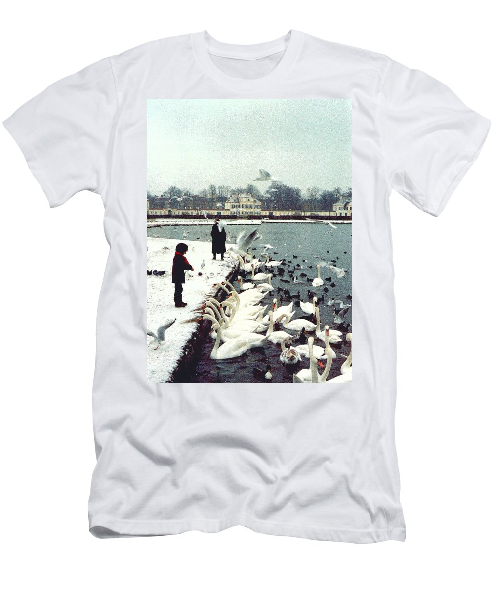 Swans Men's T-Shirt (Athletic Fit) featuring the photograph Boy Feeding Swans- Germany by Nancy Mueller