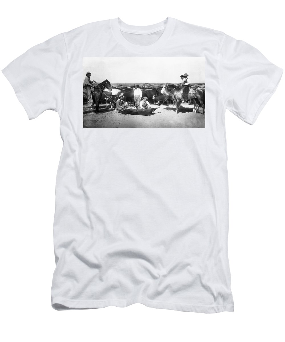 cattle Branding Men's T-Shirt (Athletic Fit) featuring the photograph Cowboys Branding Cattle C. 1900 by Daniel Hagerman