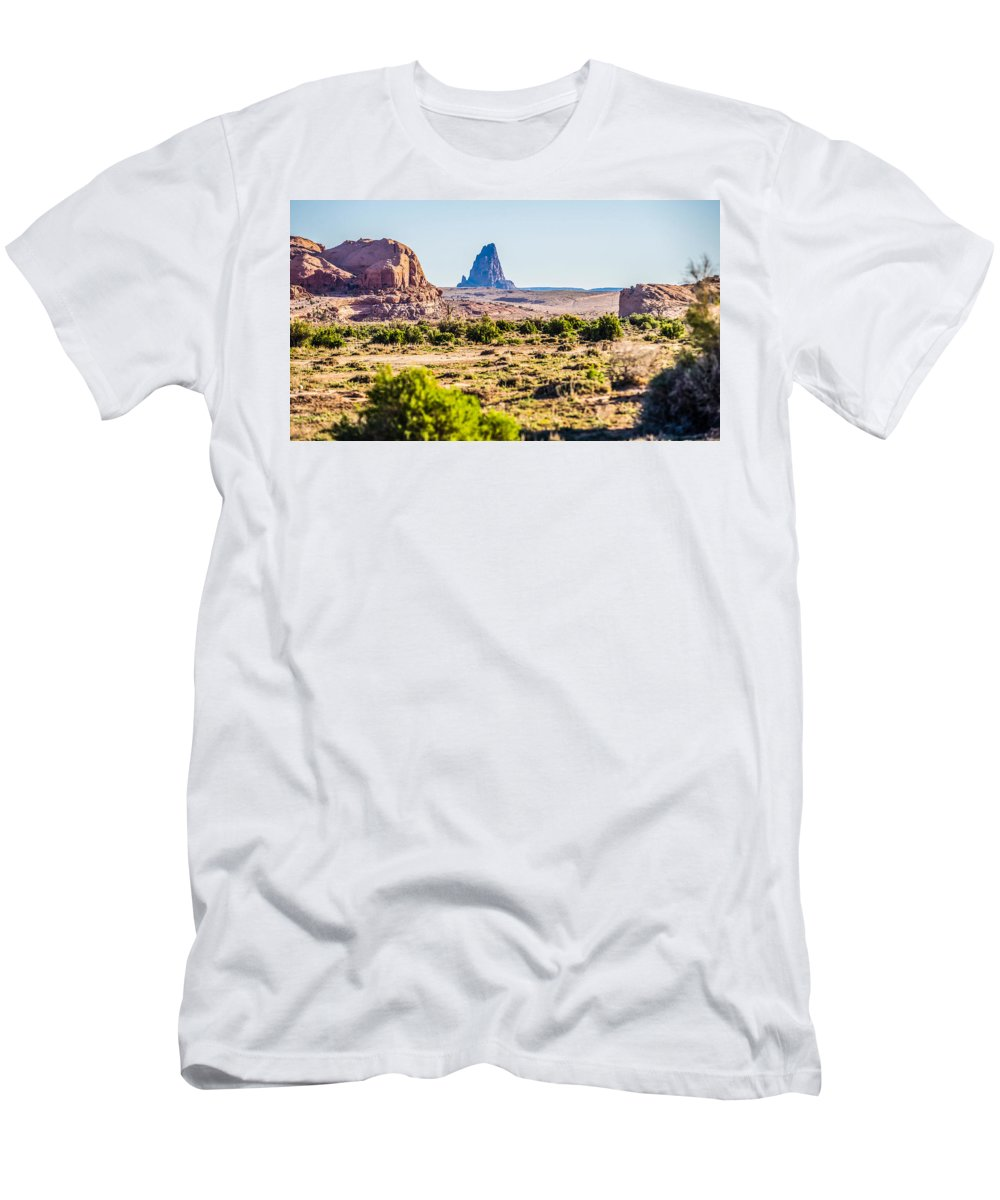 Deserts Men's T-Shirt (Athletic Fit) featuring the photograph El Capitan Peak Just North Of Kayenta Arizona In Monument Valley by Alex Grichenko