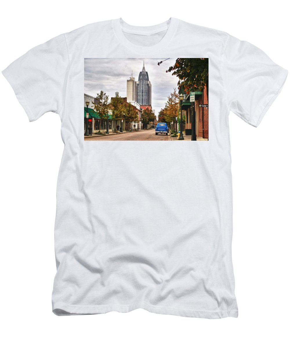 Car Men's T-Shirt (Athletic Fit) featuring the digital art Looking Down Dauphin Street And The Blue Truck by Michael Thomas
