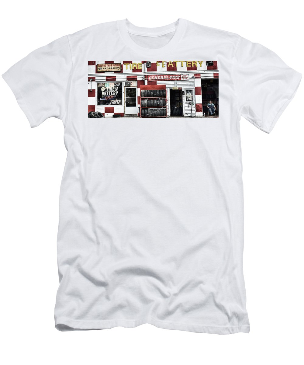 Joes Tires Men's T-Shirt (Athletic Fit) featuring the photograph Tires And Battery by Steve Archbold