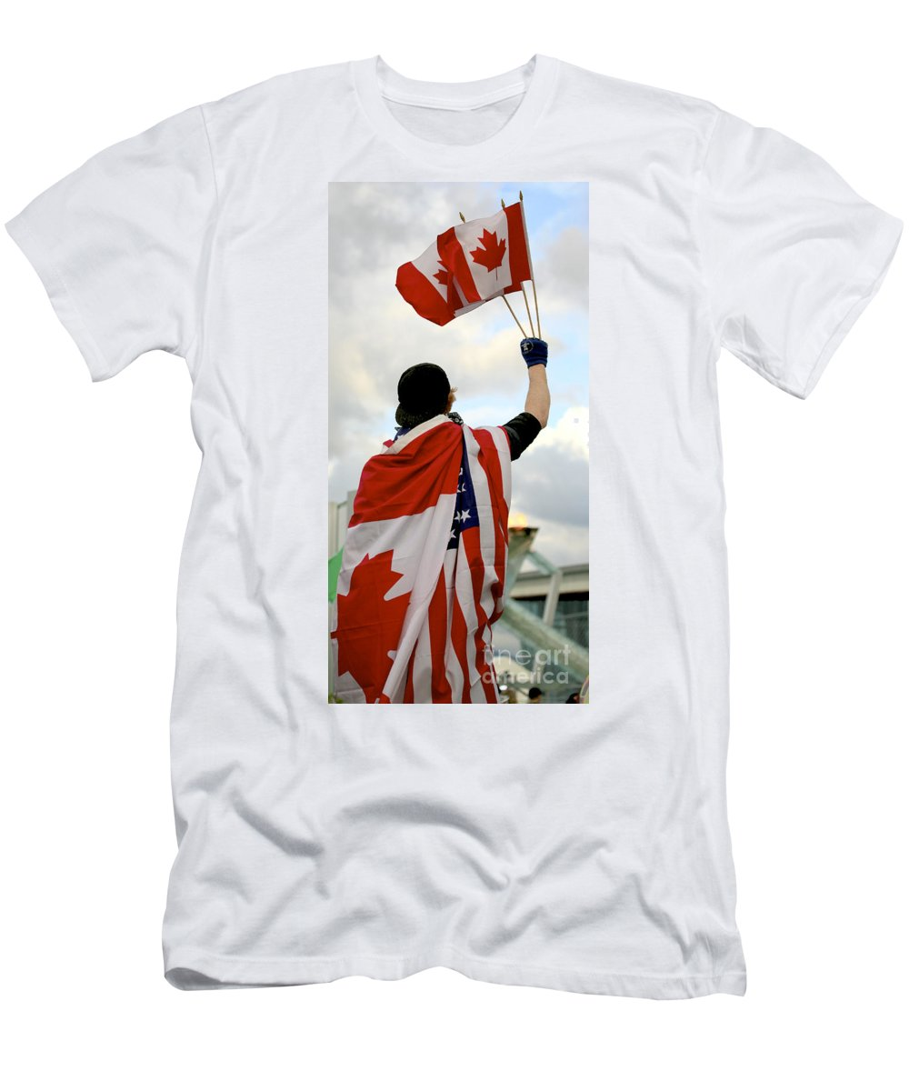 Canada Men's T-Shirt (Athletic Fit) featuring the photograph Waving The Flag by Chris Dutton