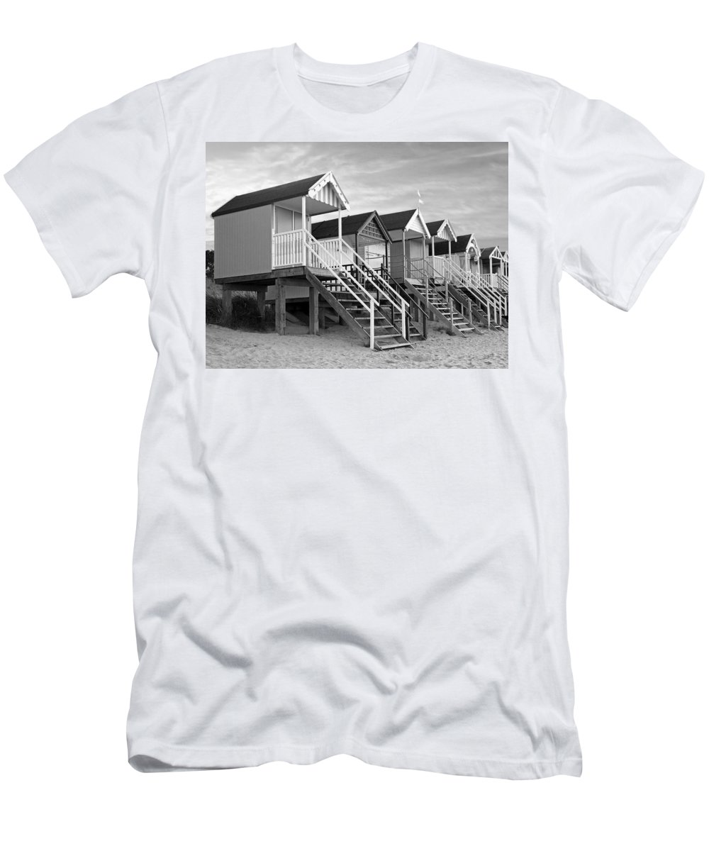 Beach Huts Men's T-Shirt (Athletic Fit) featuring the photograph Beach Huts Sunset In Black And White by Gill Billington
