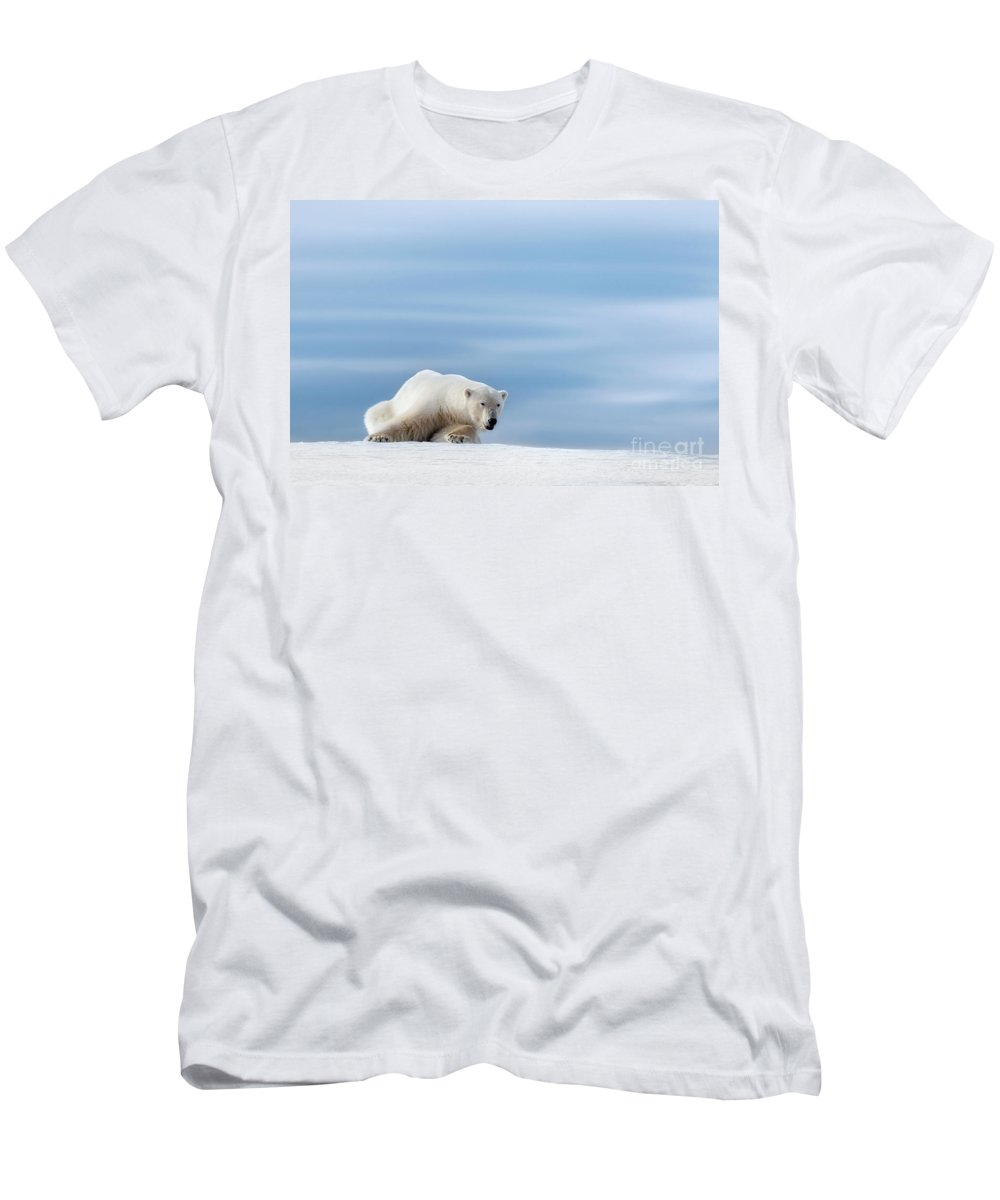 Polar Men's T-Shirt (Athletic Fit) featuring the photograph Polar Bear Crouching On The Frozen Snow Of Svalbard by Jane Rix