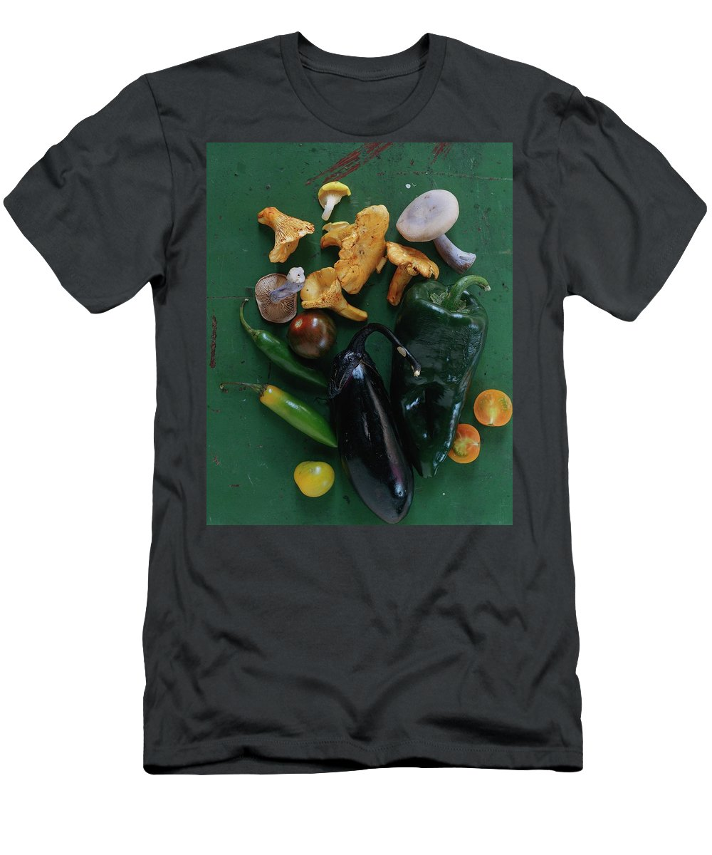 Fruits Men's T-Shirt (Athletic Fit) featuring the photograph A Pile Of Vegetables by Romulo Yanes