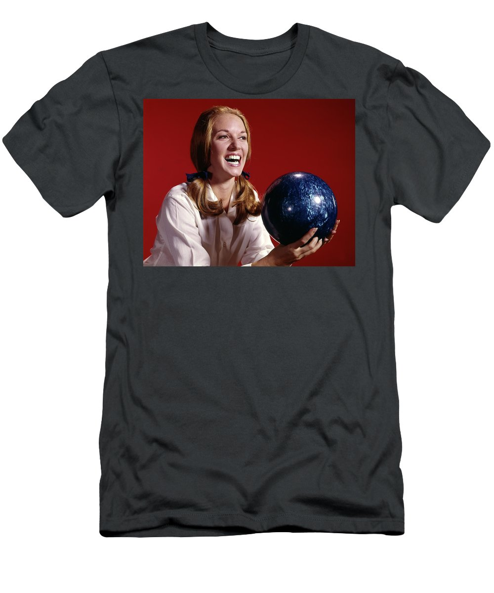 Photography Men's T-Shirt (Athletic Fit) featuring the photograph 1960s Laughing Young Woman Holding by Vintage Images