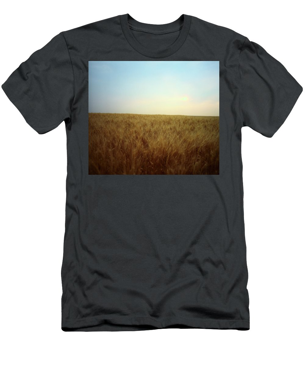 Abundance Men's T-Shirt (Athletic Fit) featuring the photograph A Barley Crop Sways In The Wind by Todd Korol