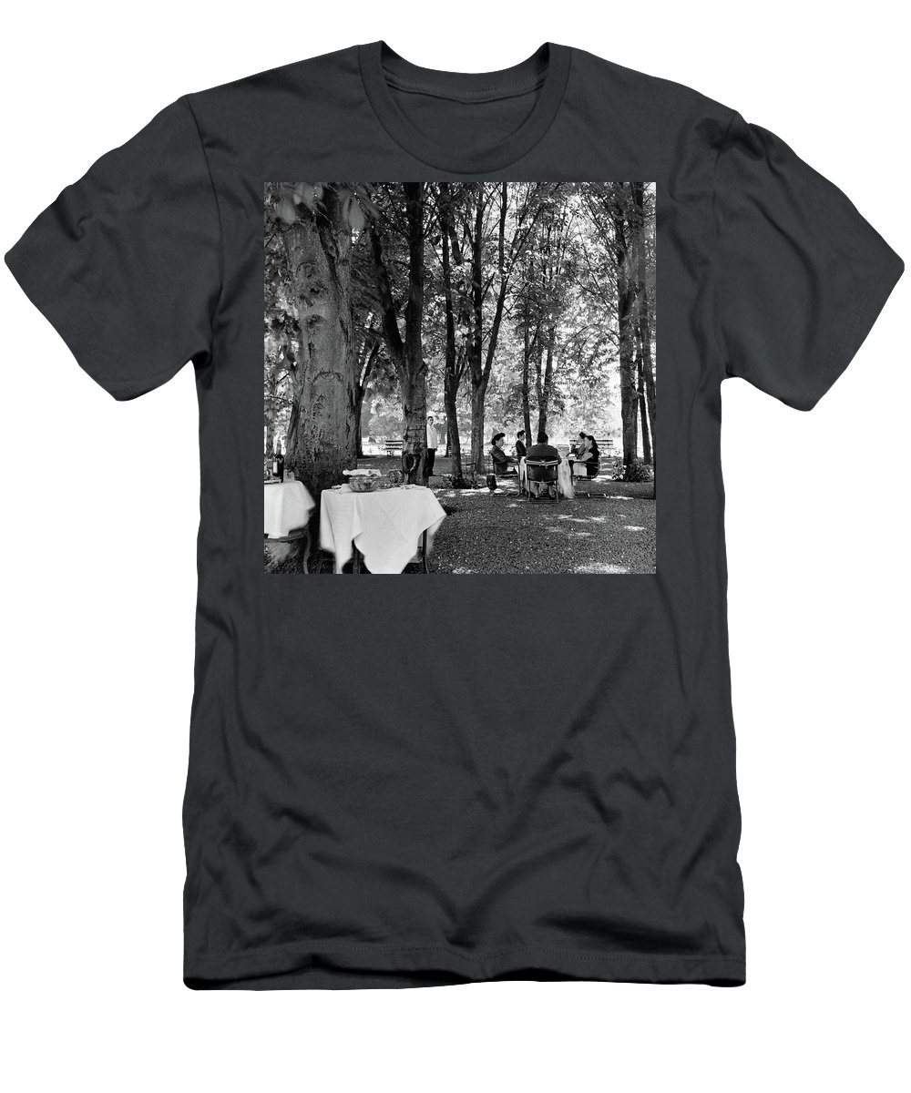 Food T-Shirt featuring the photograph A Group Of People Eating Lunch Under Trees by Luis Lemus