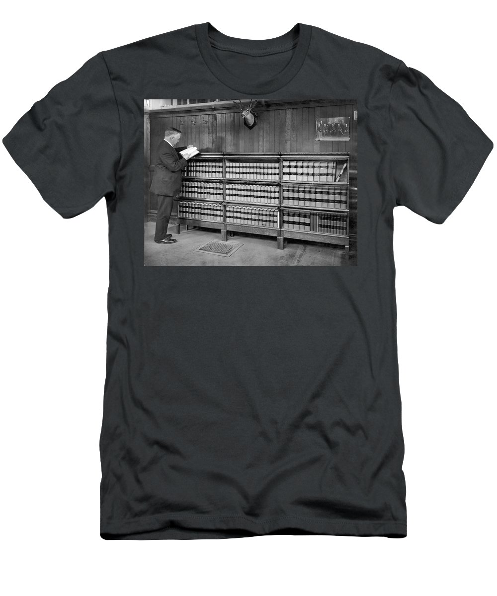 1 Person Men's T-Shirt (Athletic Fit) featuring the photograph A Lawyer In His Library by Underwood Archives
