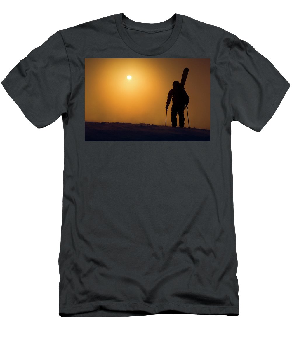 Action Men's T-Shirt (Athletic Fit) featuring the photograph A Man Hikes Up A Mountain At Sunrise by Jimmy Chin