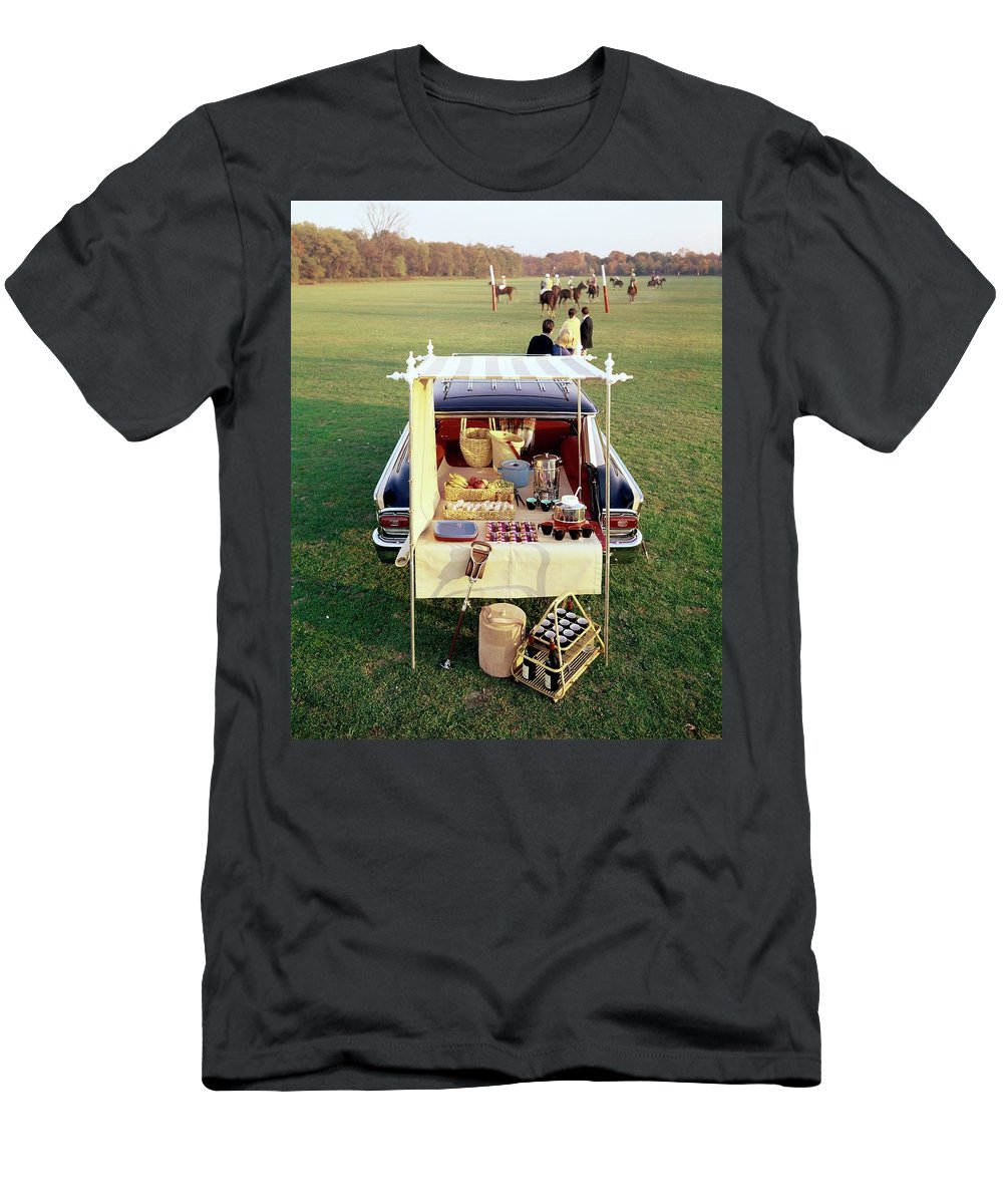 Food T-Shirt featuring the photograph A Picnic Table Set Up On The Back Of A Car by Rudy Muller