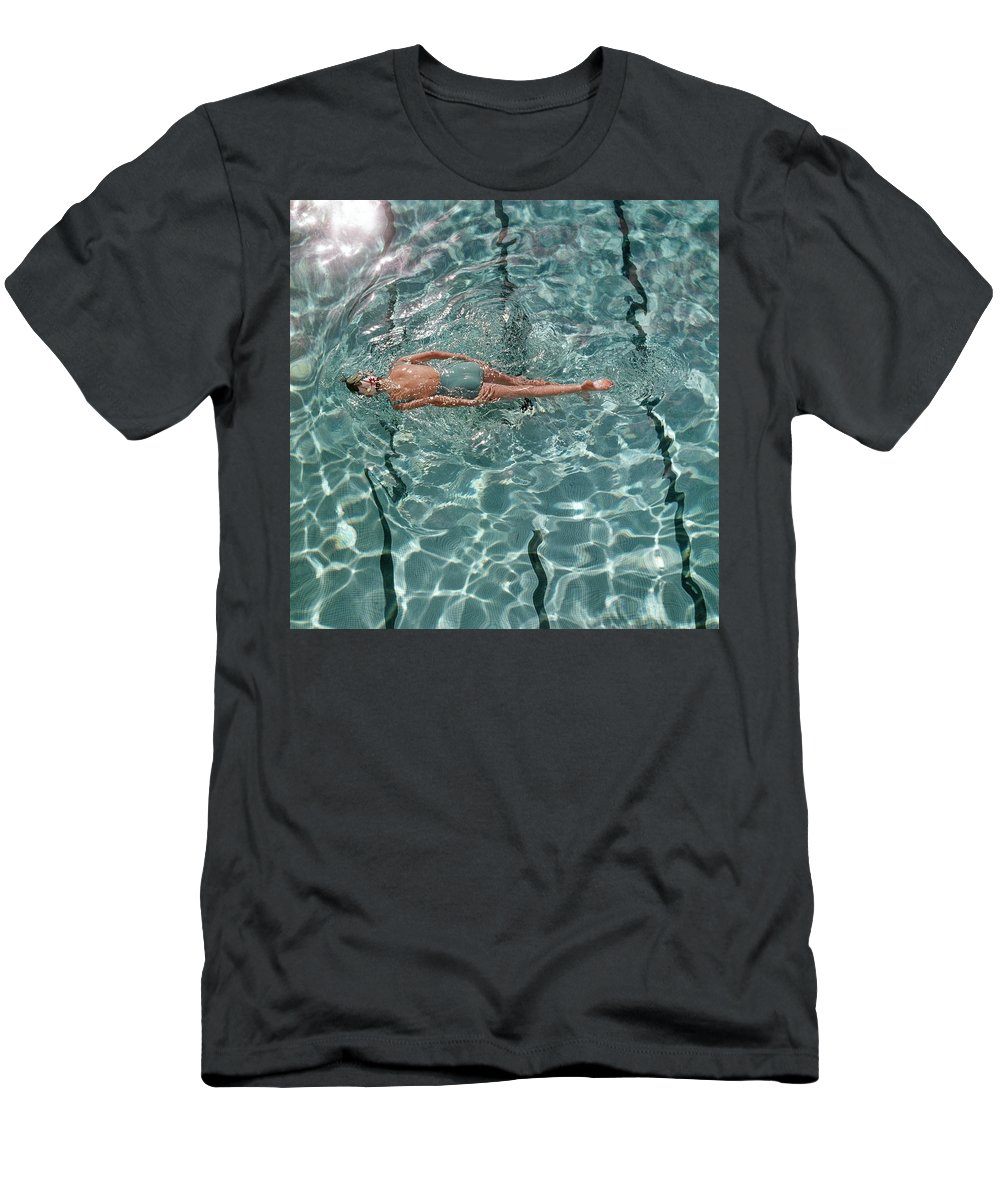Water Men's T-Shirt (Athletic Fit) featuring the photograph A Woman Swimming In A Pool by Fred Lyon