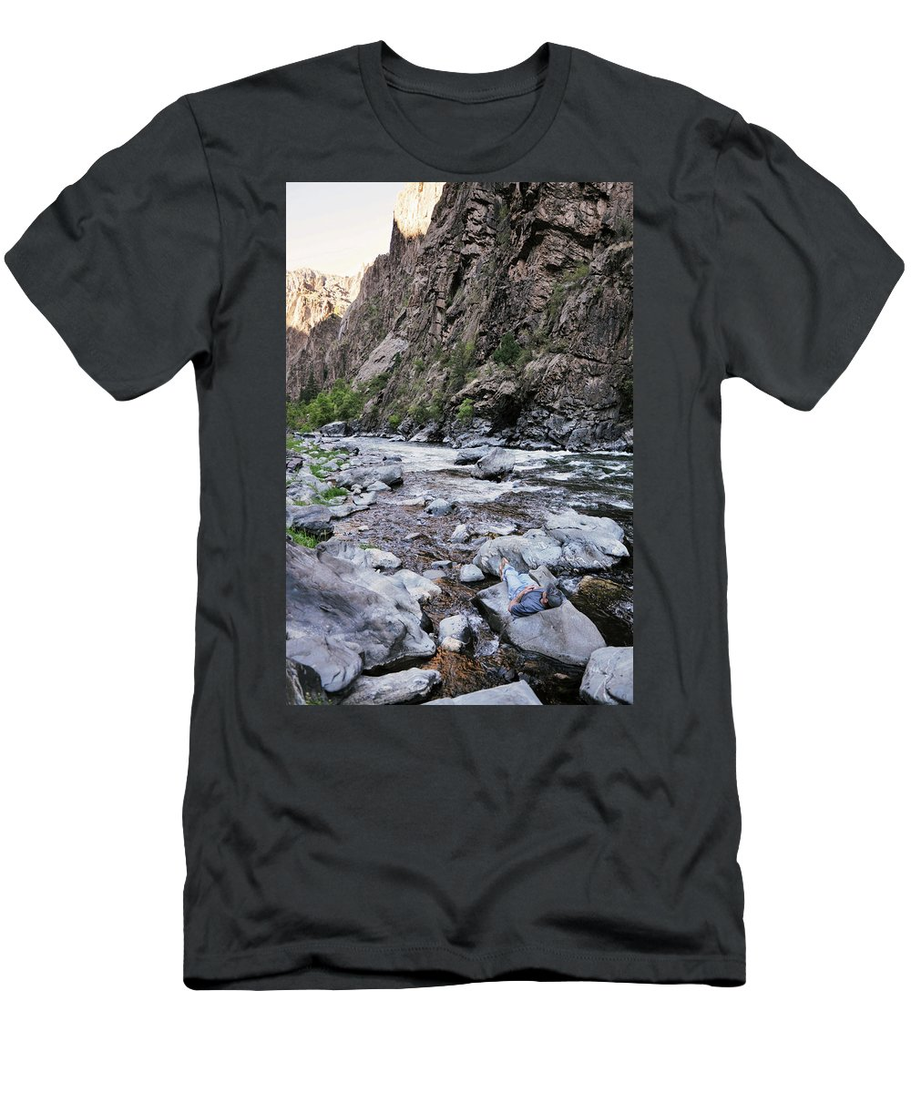 Backpacker Men's T-Shirt (Athletic Fit) featuring the photograph A Young Man Lays Back And Relaxes by Bud Force