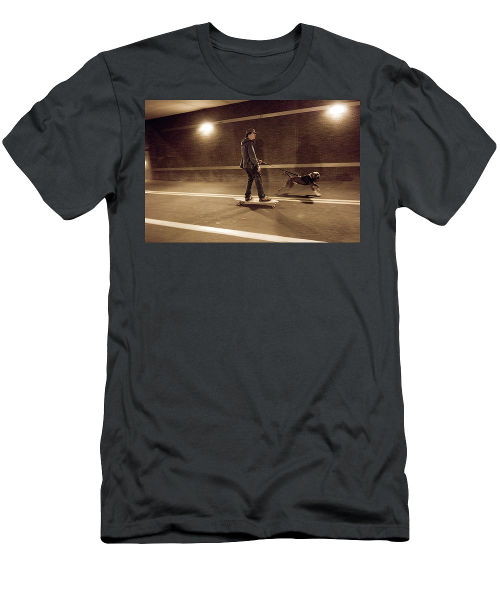 Animal Men's T-Shirt (Athletic Fit) featuring the photograph A Young Man On A Skateboard Is Pulled by Andrew Kornylak