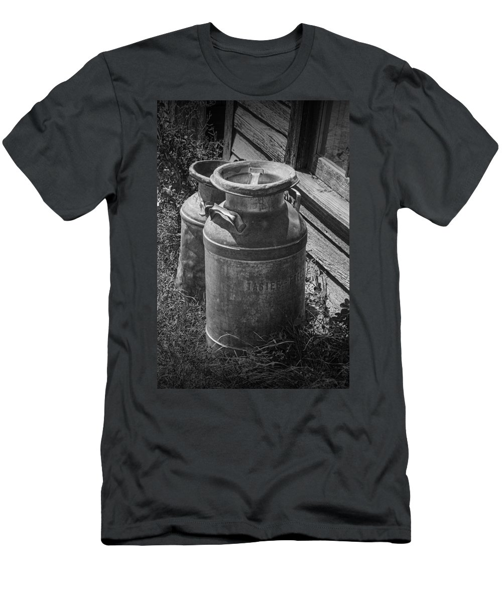 Creamery Can Men's T-Shirt (Athletic Fit) featuring the photograph Black And White Old Prairie Homestead Vintage Creamery Cans Near The Badlands by Randall Nyhof