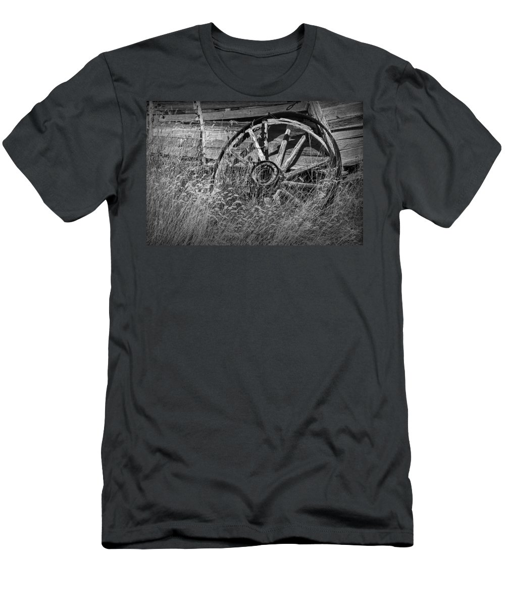 Art Men's T-Shirt (Athletic Fit) featuring the photograph Black And White Photo Of An Old Broken Wheel Of A Farm Wagon by Randall Nyhof