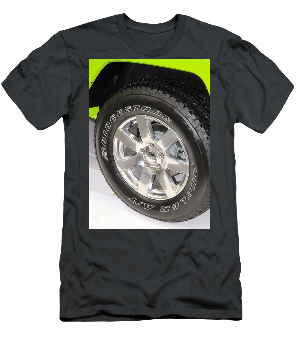 Wheel Men's T-Shirt (Athletic Fit) featuring the photograph Bridgestone Tire by Valentino Visentini
