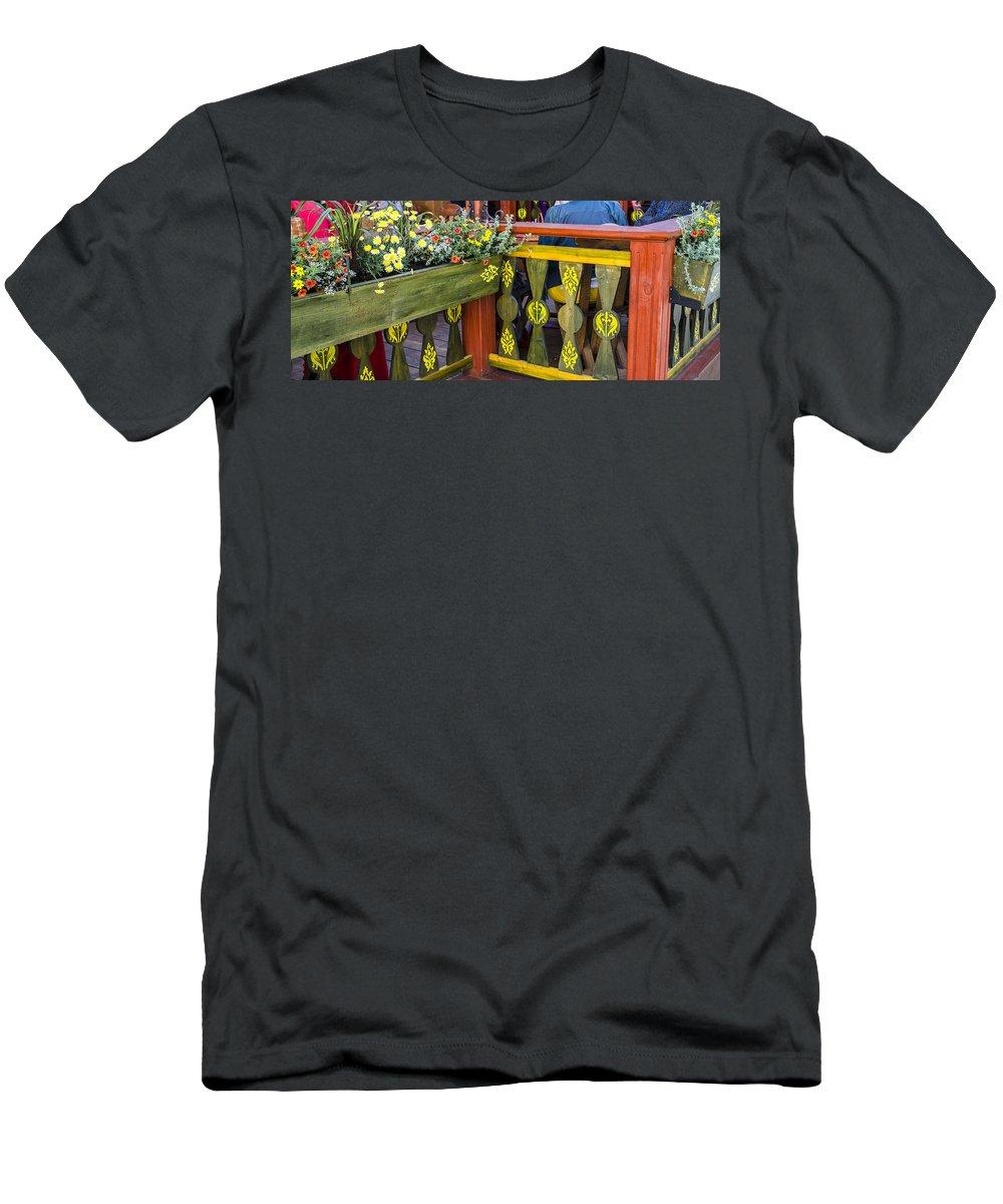 Estonia Men's T-Shirt (Athletic Fit) featuring the photograph Cafe Decor - Tallin Estonia by Jon Berghoff