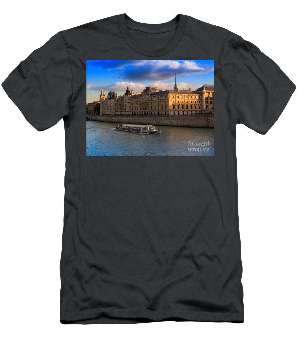 Conciergerie Men's T-Shirt (Athletic Fit) featuring the photograph Conciergerie And The Seine River Paris by Louise Heusinkveld