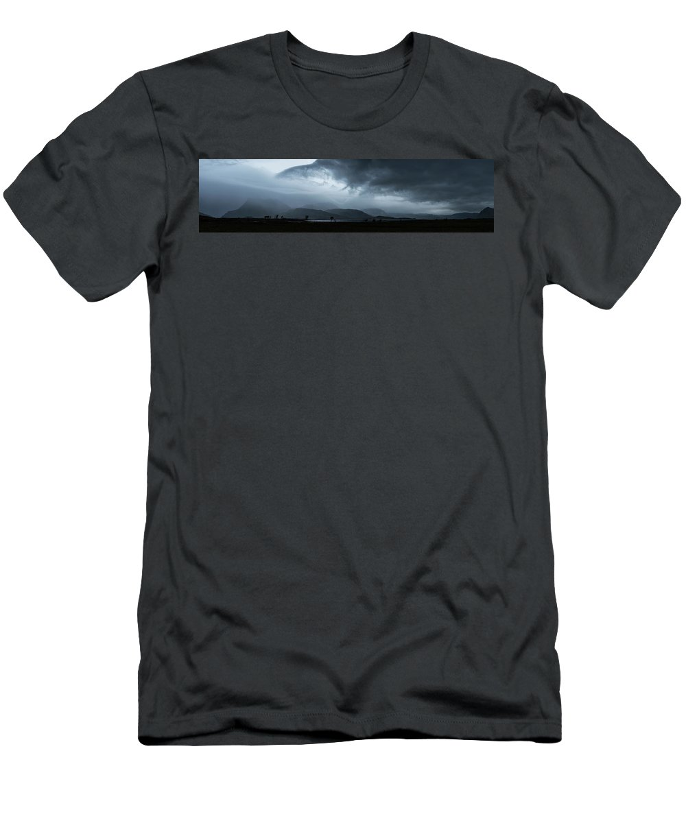 Silhouette Men's T-Shirt (Athletic Fit) featuring the photograph Dramatic Sky Over Silhouettes by Cody Duncan