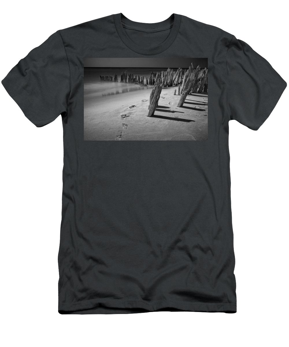 Art Men's T-Shirt (Athletic Fit) featuring the photograph Footprints In The Sand Among The Pilings by Randall Nyhof