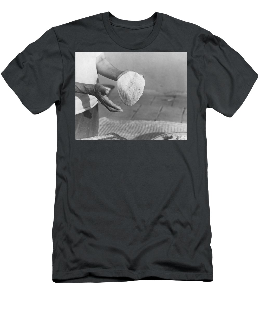 1 Person Men's T-Shirt (Athletic Fit) featuring the photograph Indian Woman Making Tortillas by Underwood Archives Onia