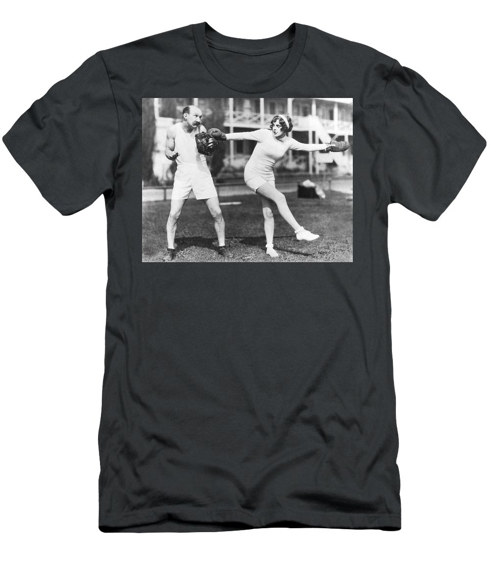 1035-1125 Men's T-Shirt (Athletic Fit) featuring the photograph Martha Sleeper Winds Up by Pathe Photo