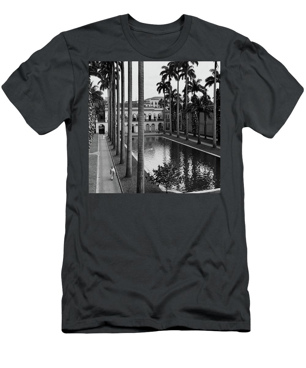 Exterior T-Shirt featuring the photograph Palm Trees Bordering A Pool by Luis Lemus