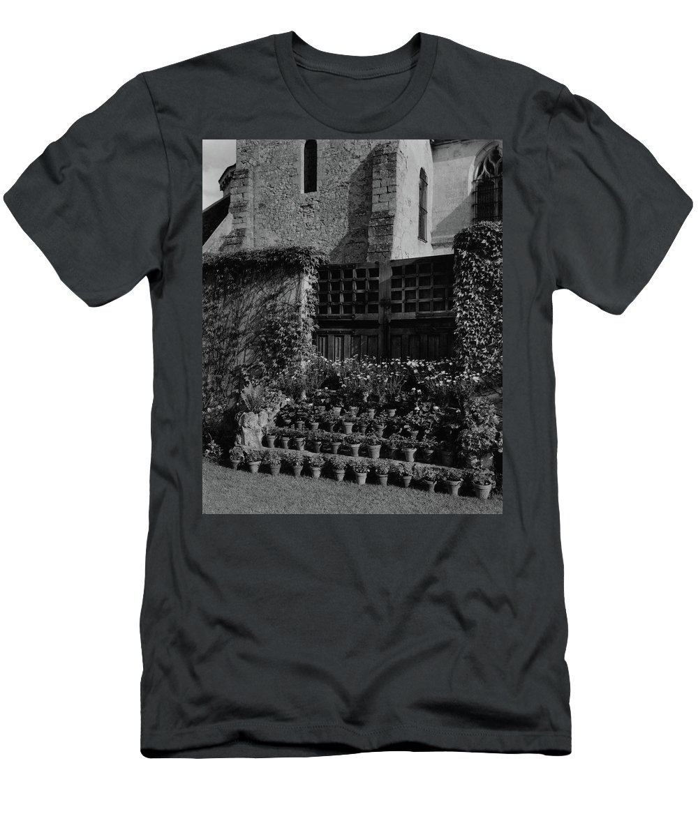 Architecture Men's T-Shirt (Athletic Fit) featuring the photograph Rows Of Pot Plants Lined On The Steps Of A Garden by Emelie Danielson