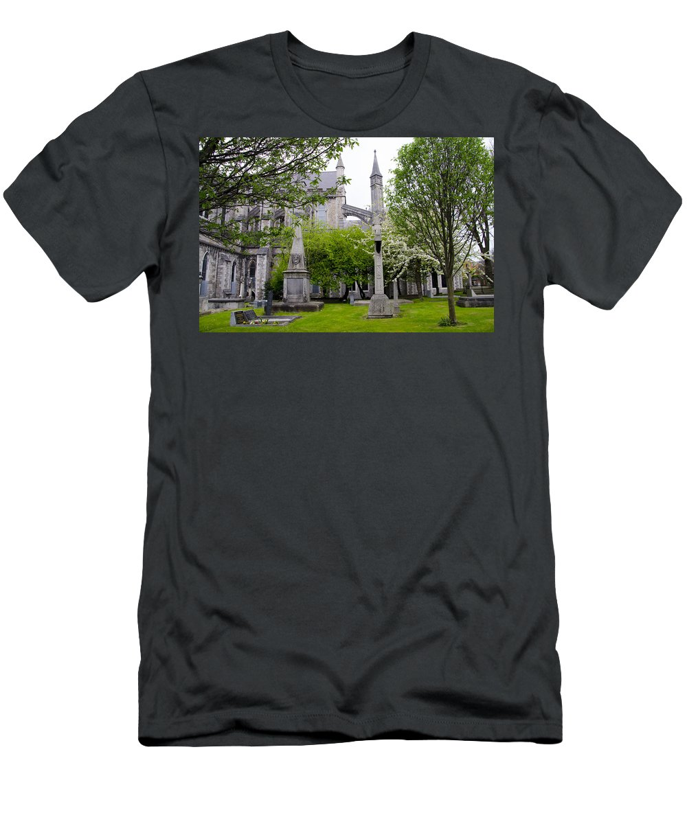 Patricks Men's T-Shirt (Athletic Fit) featuring the photograph St Patricks Cathedral - Dublin Ireland by Bill Cannon