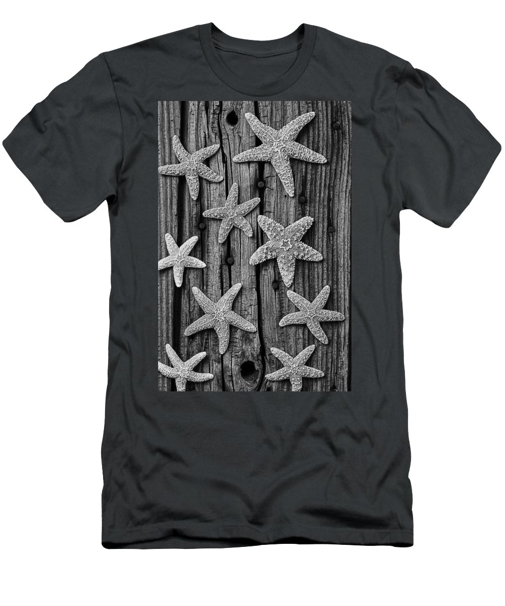 Starfish Men's T-Shirt (Athletic Fit) featuring the photograph Starfish On Old Wood Black And White by Garry Gay