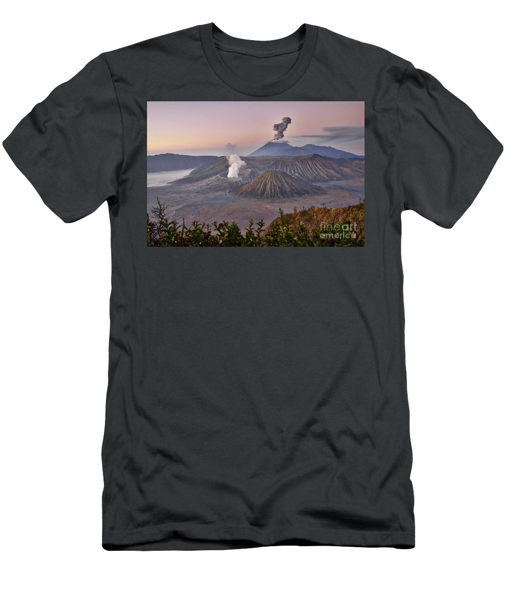 Adventure Men's T-Shirt (Athletic Fit) featuring the photograph sunrise at vulcano Bromo with sea of sand vulcano Semeru with eruption Java Indonesia by Juergen Ritterbach