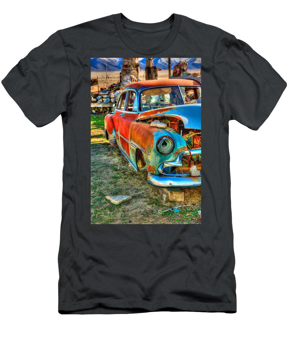 Thunder Mountain Indian Monument Men's T-Shirt (Athletic Fit) featuring the photograph The Tired Chevy 2 by Richard J Cassato