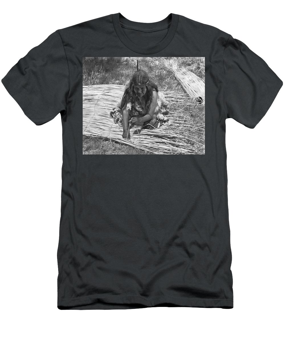 1 Person Men's T-Shirt (Athletic Fit) featuring the photograph Weaving Tules Into Walls by Underwood Archives Onia