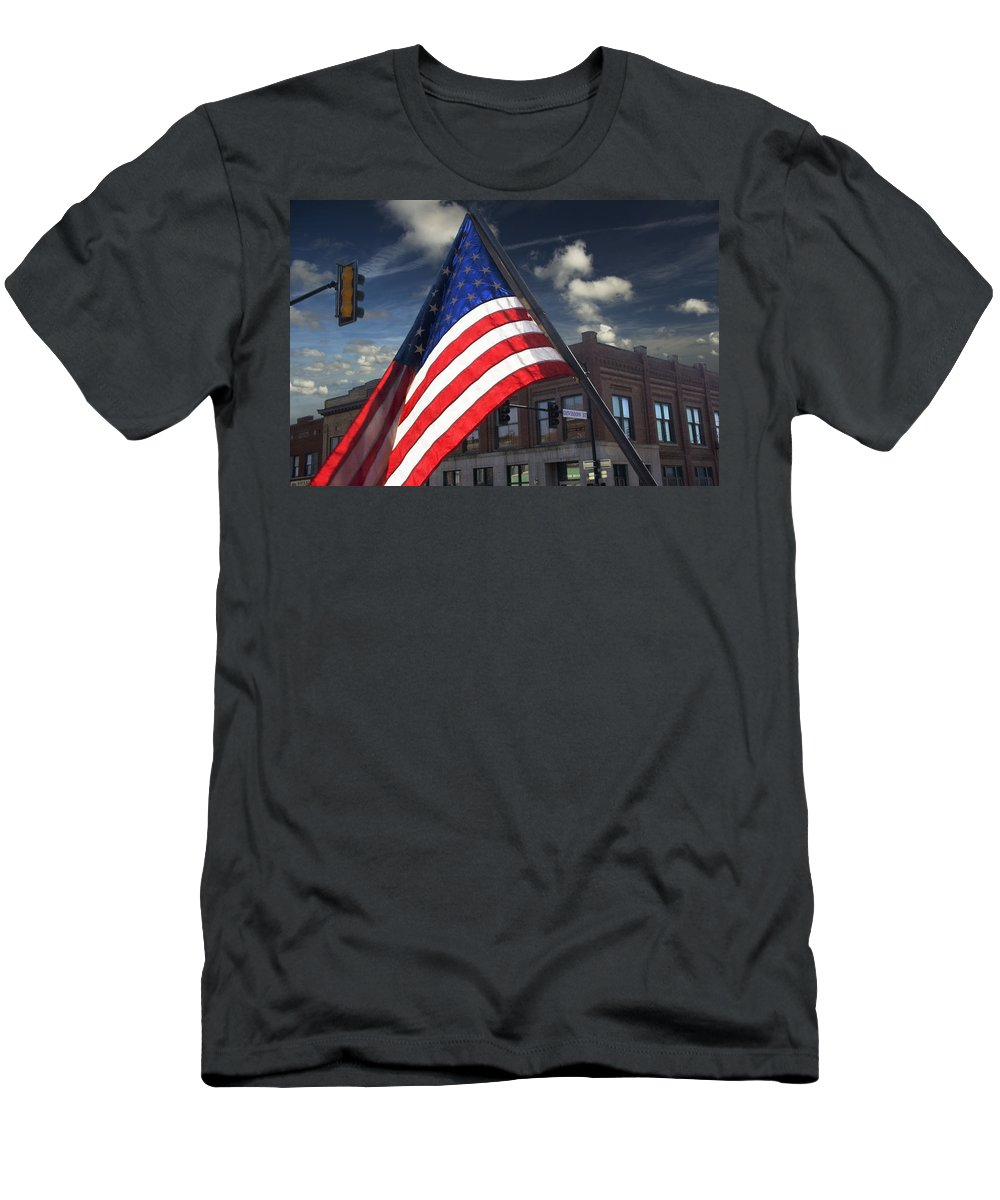 Art Men's T-Shirt (Athletic Fit) featuring the photograph American Flag Flowing In Urban Landscape by Randall Nyhof