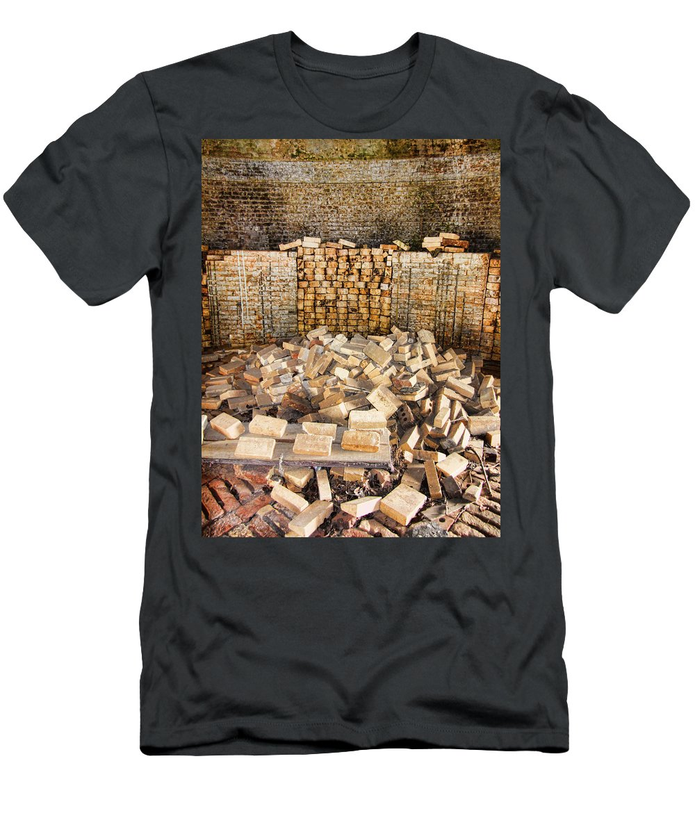Antique Men's T-Shirt (Athletic Fit) featuring the photograph Left Over Brick In Antique Brick Kiln by Kathy Clark