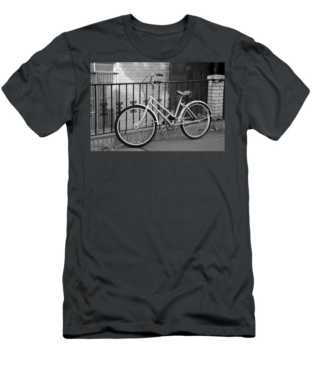 Black And White Men's T-Shirt (Athletic Fit) featuring the photograph Lonely Bike In Black And White by Rob Hans