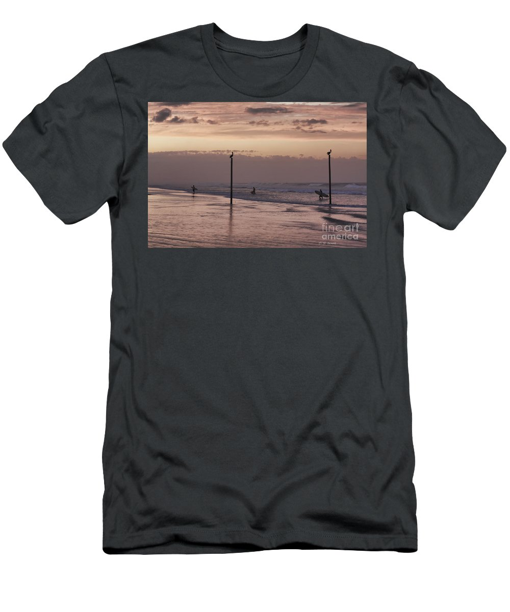 Surfers Men's T-Shirt (Athletic Fit) featuring the photograph Surfers Pelicans And Pink Sky by Deborah Benoit