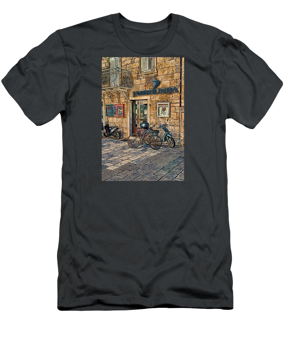 Croatia Men's T-Shirt (Athletic Fit) featuring the photograph The Ferry Ticket Office Corfu Croatia by Tom Prendergast