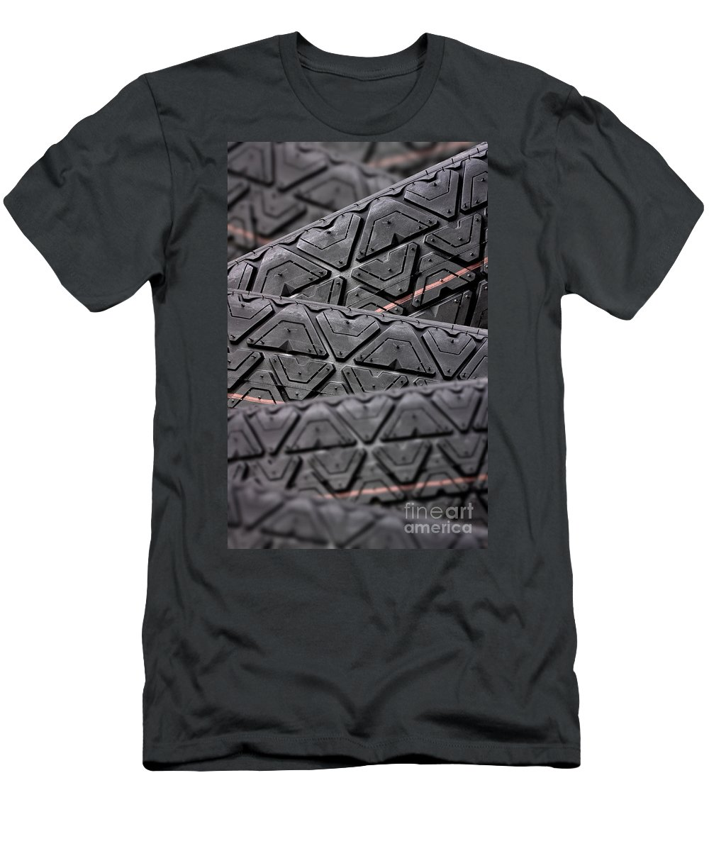 Automobile Men's T-Shirt (Athletic Fit) featuring the photograph Tyres Stacked With Focus Depth by Simon Bratt Photography LRPS