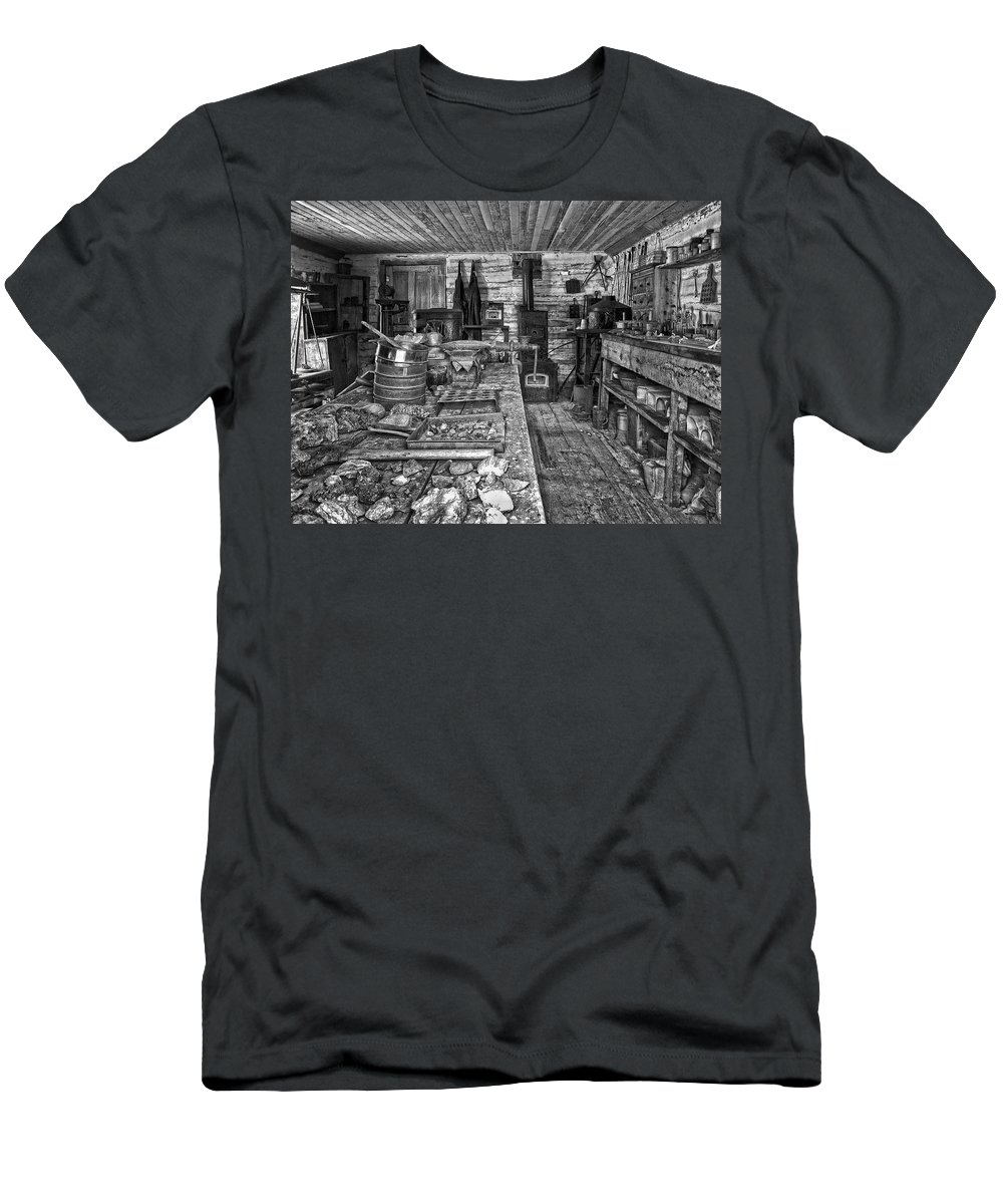 Miner Men's T-Shirt (Athletic Fit) featuring the photograph 1860's Ore Assay Office Shop - Montana by Daniel Hagerman