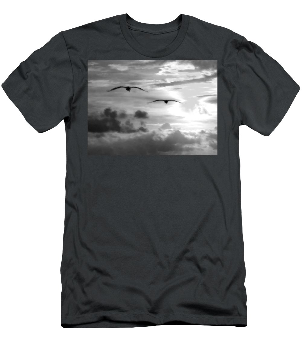 Pelican Men's T-Shirt (Athletic Fit) featuring the digital art 2 Pelicans Flying Into The Clouds by Michael Thomas